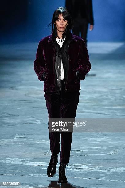 Jamie Bochert walks the runway during the Berluti Menswear Fall/Winter 20172018 show as part of Paris Fashion Week on January 20 2017 in Paris France