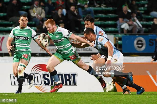 Jamie Booth of Manawatu beats Sam Nock of Northland during the round six Mitre 10 Cup match between Manawatu and Northland at Central Energy Trust...