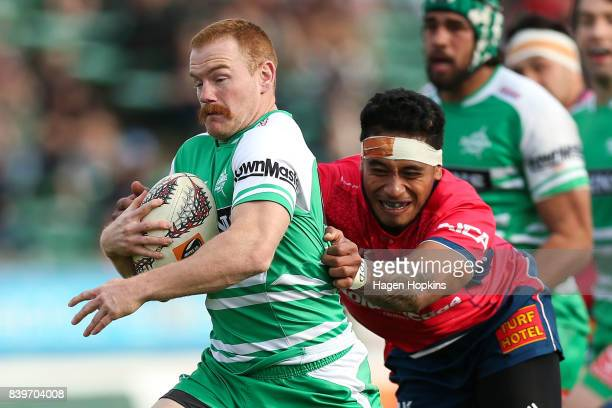 Jamie Booth of Manawatu is tackled by Shannon Frizell of Tasman during the Mitre 10 Cup match between Manawatu and Tasman at Central Energy Trust...