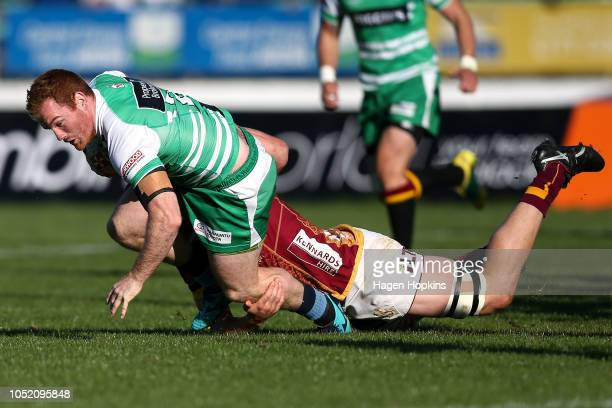 Jamie Booth of Manawatu is tackled during the round nine Mitre 10 Cup match between Manawatu and Southland at Central Energy Trust Arena on October...