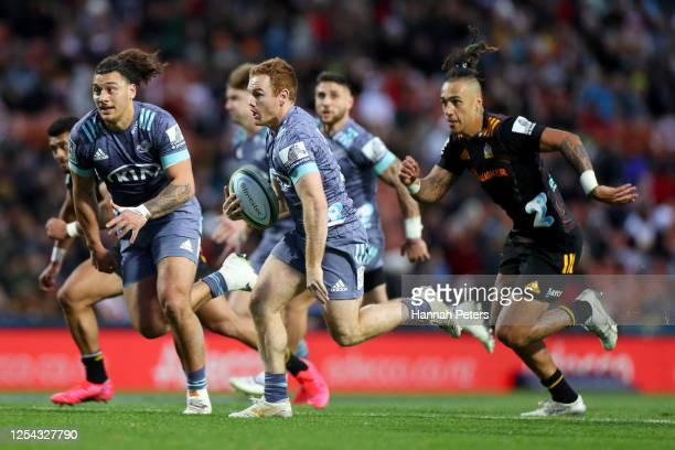 Jamie Booth of the Hurricanes makes a break during the round 4 Super Rugby Aotearoa match between the Chiefs and the Hurricanes at FMG Stadium on...