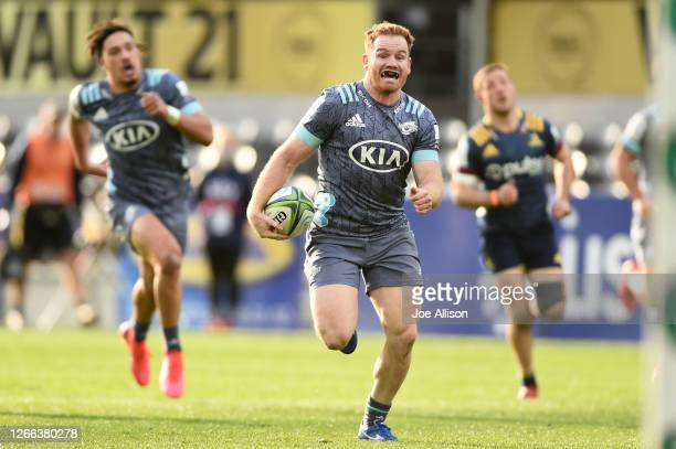 Jamie Booth of the Hurricanes runs in to score a try during the round 10 Super Rugby Aotearoa match between the Highlanders and the Hurricanes at...