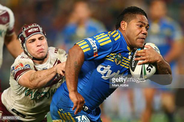 Jamie Buhrer of the Sea Eagles is beaten by Chris Sandow of the Eels during the round 24 NRL match between the Parramatta Eels and the Manly Sea...