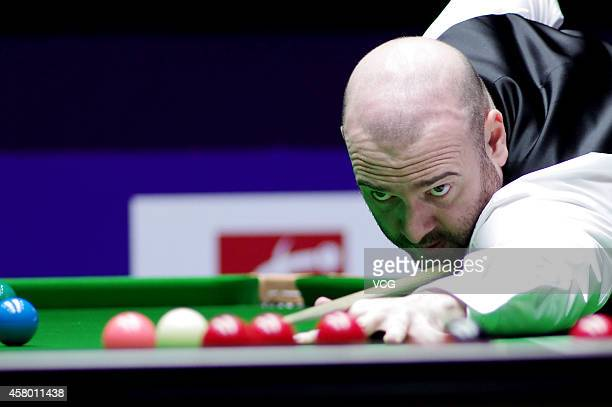 Jamie Burnett of Scotland plays a shot against Judd Trump of England on day three of the World Snooker International Championship 2014 at the Sichuan...