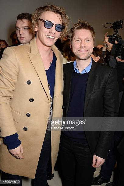 Jamie Campbell Bower and Christopher Bailey pose backstage after the Burberry Womenswear Autumn/Winter 2014 show at Kensington Gardens on February 17...