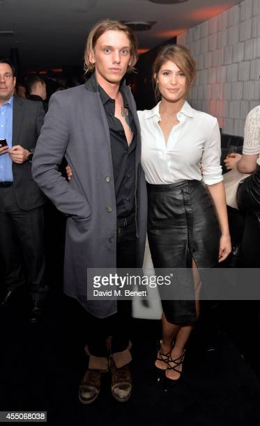 Jamie Campbell Bower and Gemma Arterton attend the Samsung Galaxy Alpha launch event at The Collection on September 9 2014 in London England