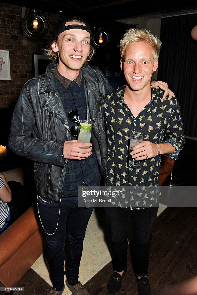 Jamie Campbell Bower (L) and Jamie Laing attend an after party following 'A Curious Night at the Theatre', a charity gala evening to raise funds for Ambitious about Autism and The National Autistic Society, at Century Club on July 1, 2013 in London, England.