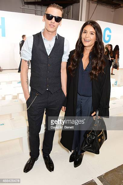 Jamie Campbell Bower and Jessie Ware attend the Topshop Unique SS15 Front Row on September 14 2014 in London England