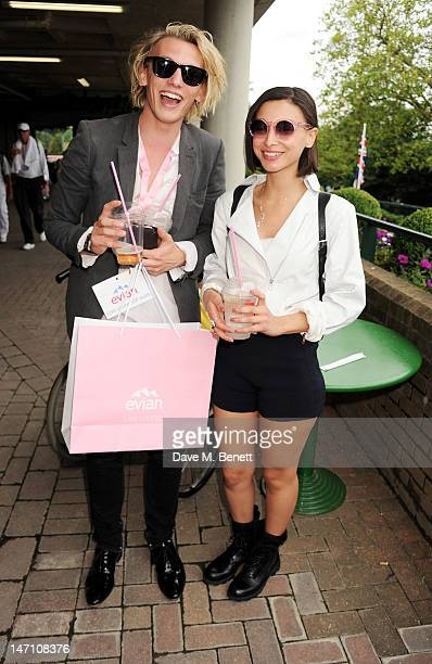 Jamie Campbell Bower and Leah Weller attend the evian 'Live young' VIP Suite at Wimbledon on June 25 2012 in London England