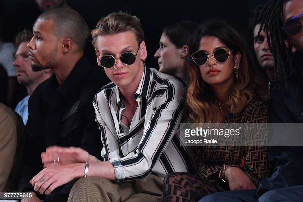 Jamie Campbell Bower and MIA attend the Fendi show during Milan Men's Fashion Week Spring/Summer 2019 on June 18 2018 in Milan Italy