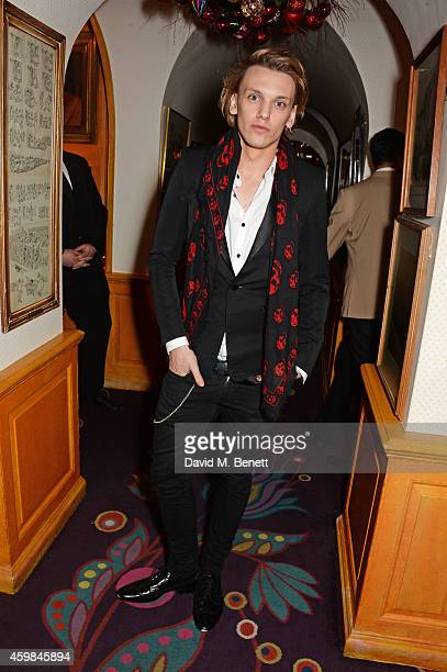 Jamie Campbell Bower attends the Chopard Christmas Party at Annabel's on December 2 2014 in London England