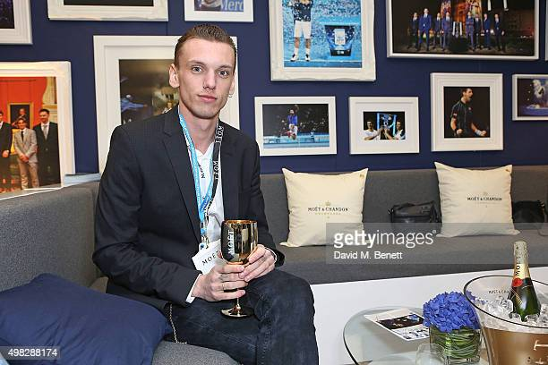 Jamie Campbell Bower celebrates with Moet Chandon whilst raising a toast to the winners of the 2015 Barclays ATP World Tour Finals at The O2 Arena on...