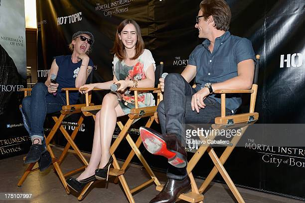 Jamie Campbell Bower Lily Collins and Kevin Zegers of 'The Mortal Instruments' at Dolphin Mall on July 31 2013 in Miami Florida