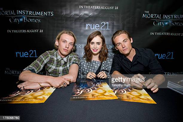 Jamie Campbell Bower Lily Collins and Kevin Zegers sign autographs for fans in anticipation of Screen Gems' actionfantasy THE MORTAL INSTRUMENTS CITY...