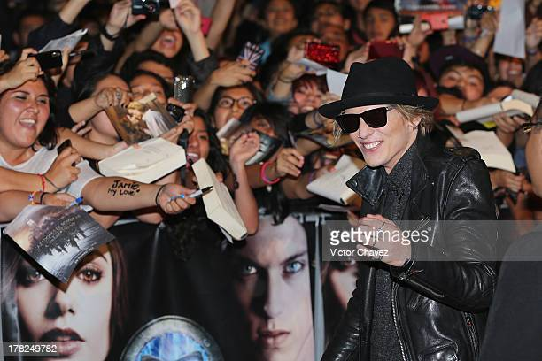 Jamie Campbell Bower signs autographs to fans during The Mortal Instruments City of Bones Mexico City screening at Auditorio Nacional on August 27...