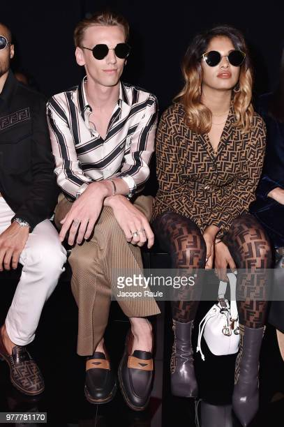 Jamie Campbell Bowerm and MIA attend the Fendi show during Milan Men's Fashion Week Spring/Summer 2019 on June 18 2018 in Milan Italy