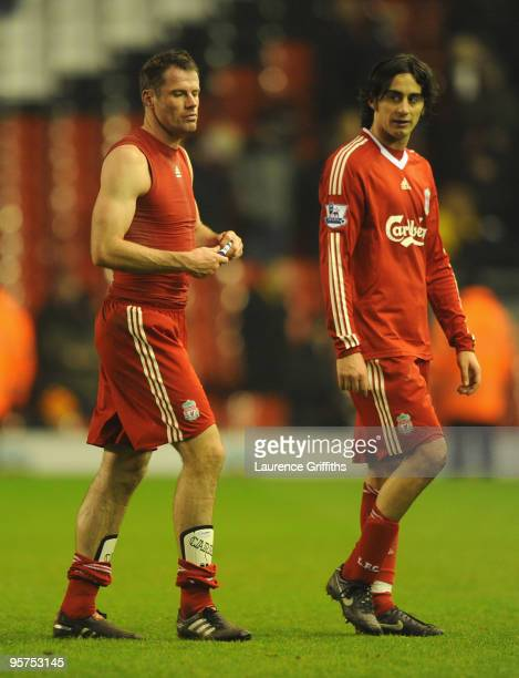 Jamie Carragher and Alberto Aquilani of Liverpool leave the pitch at the end of the FA Cup sponsored by EON 3rd Round Replay match between Liverpool...