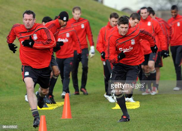 Jamie Carragher and Captain Steven Gerrard during a Liverpool FC training session at Melwood Training Ground on February 5 2010 in Liverpool England