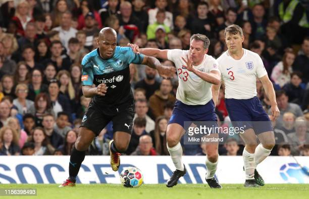 Jamie Carragher and Didier Drogba during Soccer Aid 2019 at Stamford Bridge on June 16 2019 in London England
