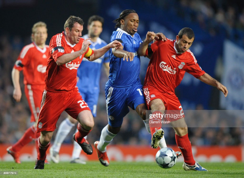 Jamie Carragher (L) and Javier Mascherano of Liverpool challenge Didier Drogba of Chelsea during the UEFA Champions League Quarter Final Second Leg match between Chelsea and Liverpool at Stamford Bridge on April 14, 2009 in London, England.