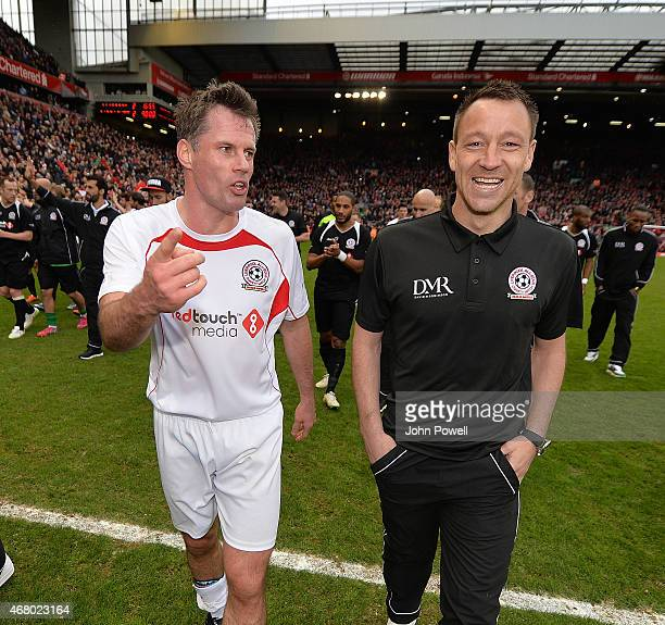 Jamie Carragher and John Terry at the end of the Liverpool All Star Charity Match at Anfield on March 29 2015 in Liverpool England