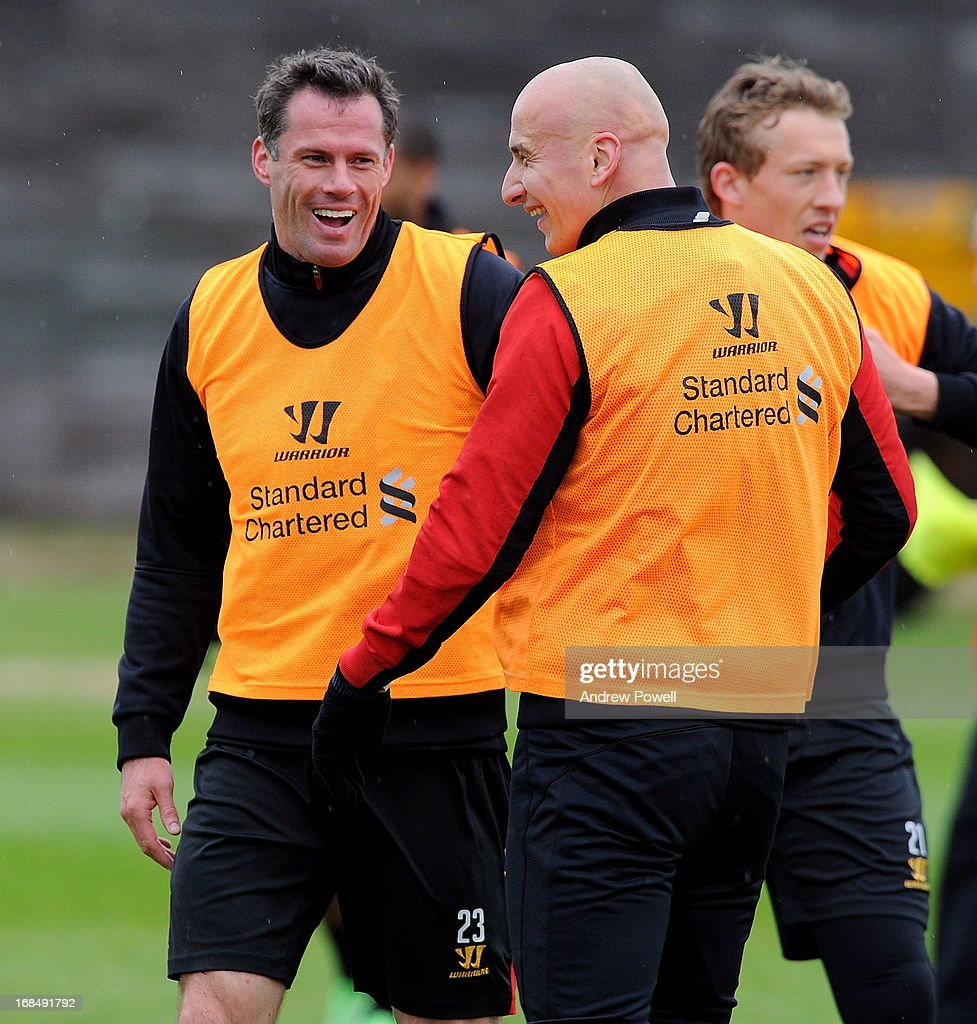 Jamie Carragher and Jonjo Shelvey (R) of Liverpool laugh together during a training session at Melwood Training Ground on May 10, 2013 in Liverpool, England.