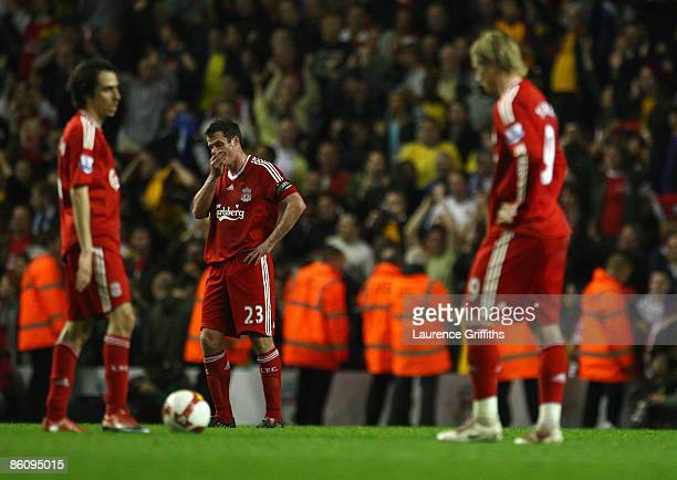 Jamie Carragher and Yossi Benayoun of Liverpool show their dejection during the Barclays Premier League match between Liverpool and Arsenal at...