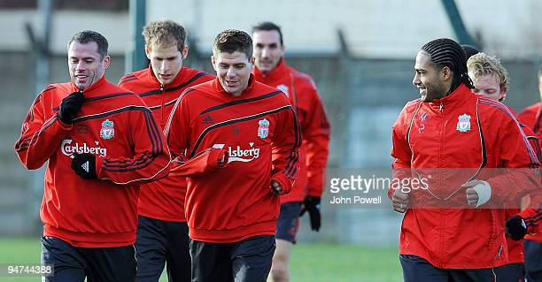 Jamie Carragher has a laugh with Steven Gerrard and Glen Johnson during a training session at Melwood Training Ground on December 18 2009 in...