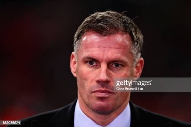 Jamie Carragher looks on before the UEFA Champions League group H match between Tottenham Hotspur and Real Madrid at Wembley Stadium on November 1...