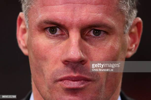 Jamie Carragher looks on during the UEFA Champions League group H match between Tottenham Hotspur and Real Madrid at Wembley Stadium on November 1...