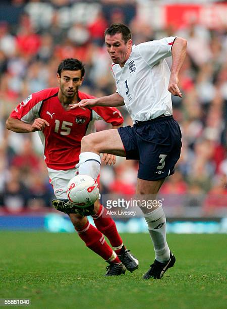Jamie Carragher of England clears from Yuksel Sariyar of Austria during the World Cup 2006 Group 6 qualifying match between England and Austria at...
