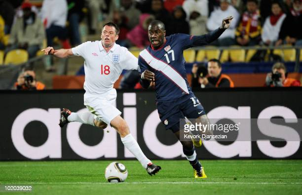 Jamie Carragher of England pursues Jozy Altidore of the United States during the 2010 FIFA World Cup South Africa Group C match between England and...