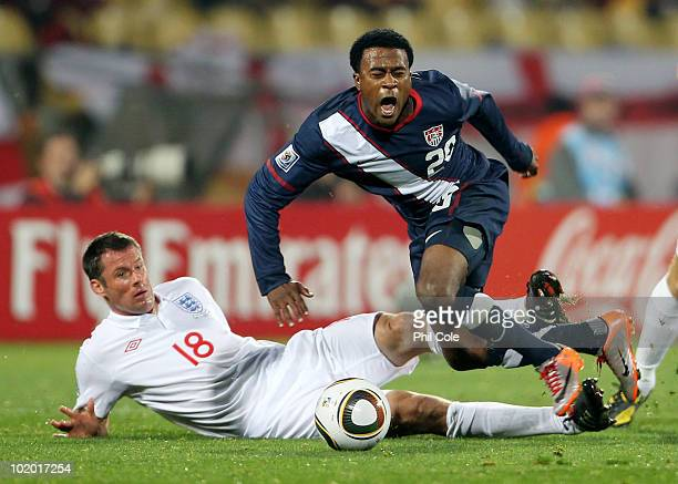 Jamie Carragher of England tackles Robbie Findley of the United States during the 2010 FIFA World Cup South Africa Group C match between England and...