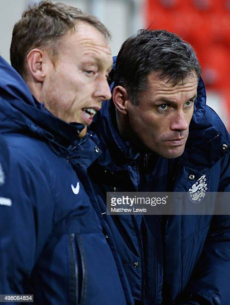 Jamie Carragher of Englandand Steve Cooper manager of England look on during the International U17 Friendly match between England U17 and Germany U17...