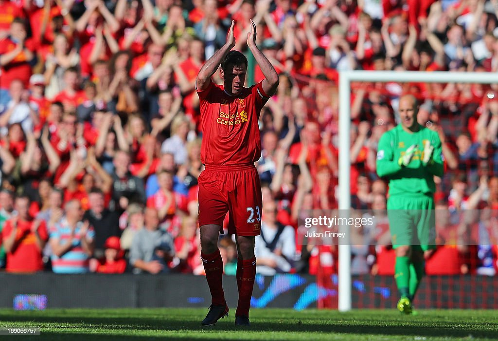 Jamie Carragher of Liverpool applauds the fans after being substituted in his last game for the club during the Barclays Premier League match between Liverpool and Queens Park Rangers at Anfield on May 19, 2013 in Liverpool, England.