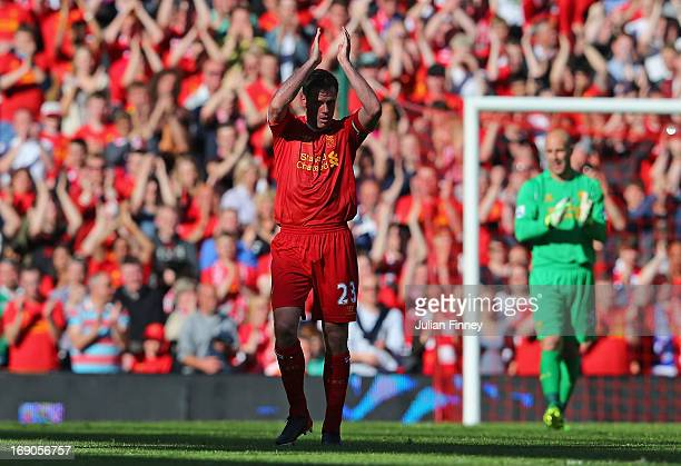 Jamie Carragher of Liverpool applauds the fans after being substituted in his last game for the club during the Barclays Premier League match between...