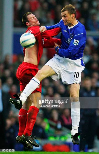 Jamie Carragher of Liverpool battles for the ball with Duncan Ferguson of Everton during the FA Barclays Premiership match between Liverpool and...