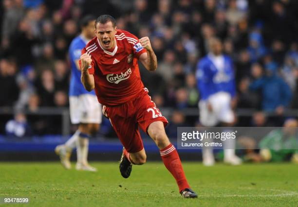 Jamie Carragher of Liverpool celebrates his team's second goal during the Barclays Premier League match between Everton and Liverpool at Goodison...