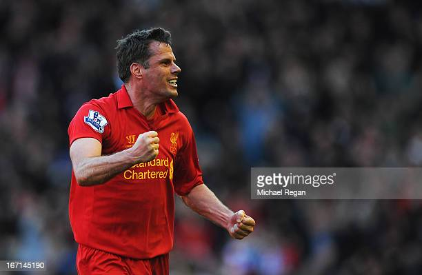 Jamie Carragher of Liverpool celebrates the equalising goal scored by Luis Suarez during the Barclays Premier League match between Liverpool and...