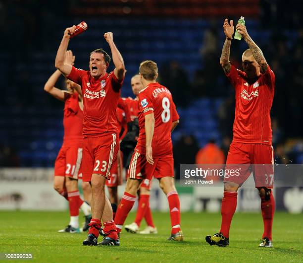 Jamie Carragher of Liverpool celebrates the win at the end of the game during the Barclay Premier League match between Bolton Wanderers and Liverpool...