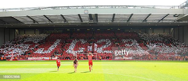 Jamie Carragher of Liverpool claps to the fans in the Kop before the Barclays Premier League match between Liverpool and Queens Park Rangers at...