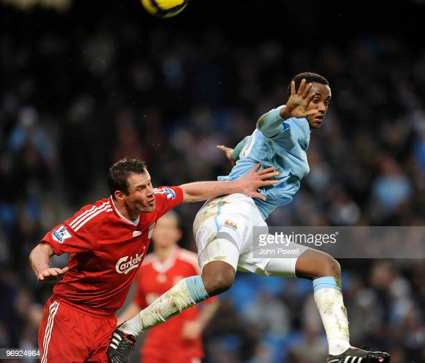 Jamie Carragher of Liverpool competes with Adbisalam Ibrahim of Manchester City during the Barclays Premier League match between Manchester City and...