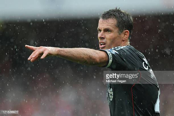 Jamie Carragher of Liverpool directs his team during the Barclays Premier League match between Arsenal and Liverpool at the Emirates Stadium on...