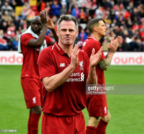 Jamie Carragher of Liverpool FC Legends showing his appreciation to the fans at the end of the friendly match between Liverpool FC Legends and AC...