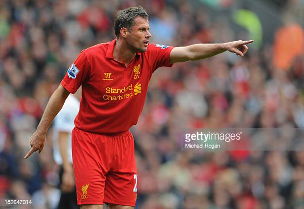 Jamie Carragher of Liverpool gestures during the Barclays Premier League match between Liverpool and Manchester United at Anfield on September 23...