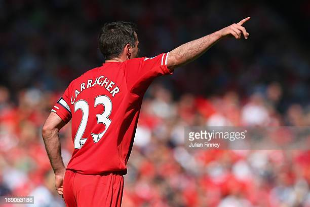 Jamie Carragher of Liverpool gestures during the Barclays Premier League match between Liverpool and Queens Park Rangers at Anfield on May 19 2013 in...