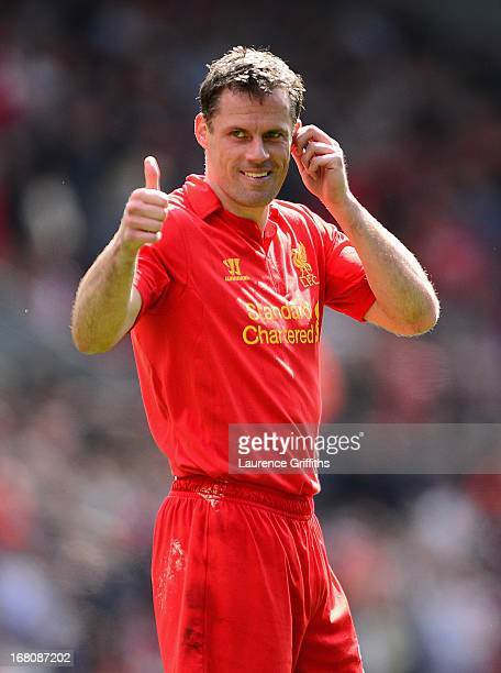 Jamie Carragher of Liverpool gives a thumbs up during the Barclays Premier League match between Liverpool and Everton at Anfield on May 5 2013 in...
