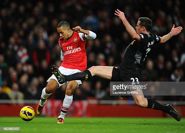 Jamie Carragher of Liverpool goes in for the tackle on Theo Walcott of Arsenal during the Barclays Premier League match between Arsenal and Liverpool...