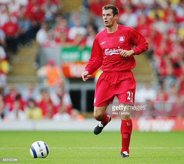 Jamie Carragher of Liverpool in action during the UEFA Champions League first qualifying round first leg match between Liverpool and TNS held at...