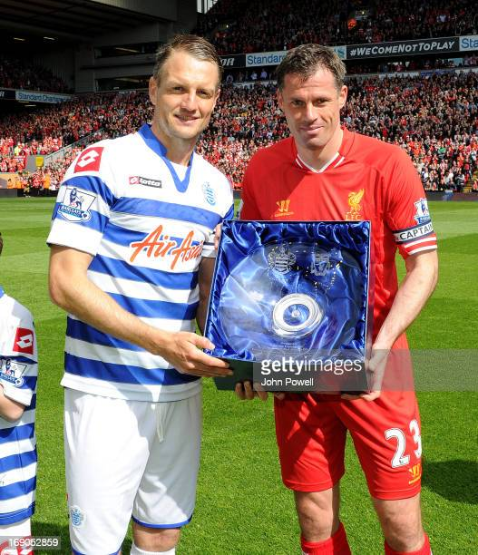 Jamie Carragher of Liverpool is given a commemorative award before the Barclays Premier League match between Liverpool and Queens Park Rangers at...